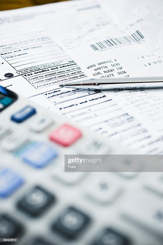 Tax Forms with Calculator and Pen