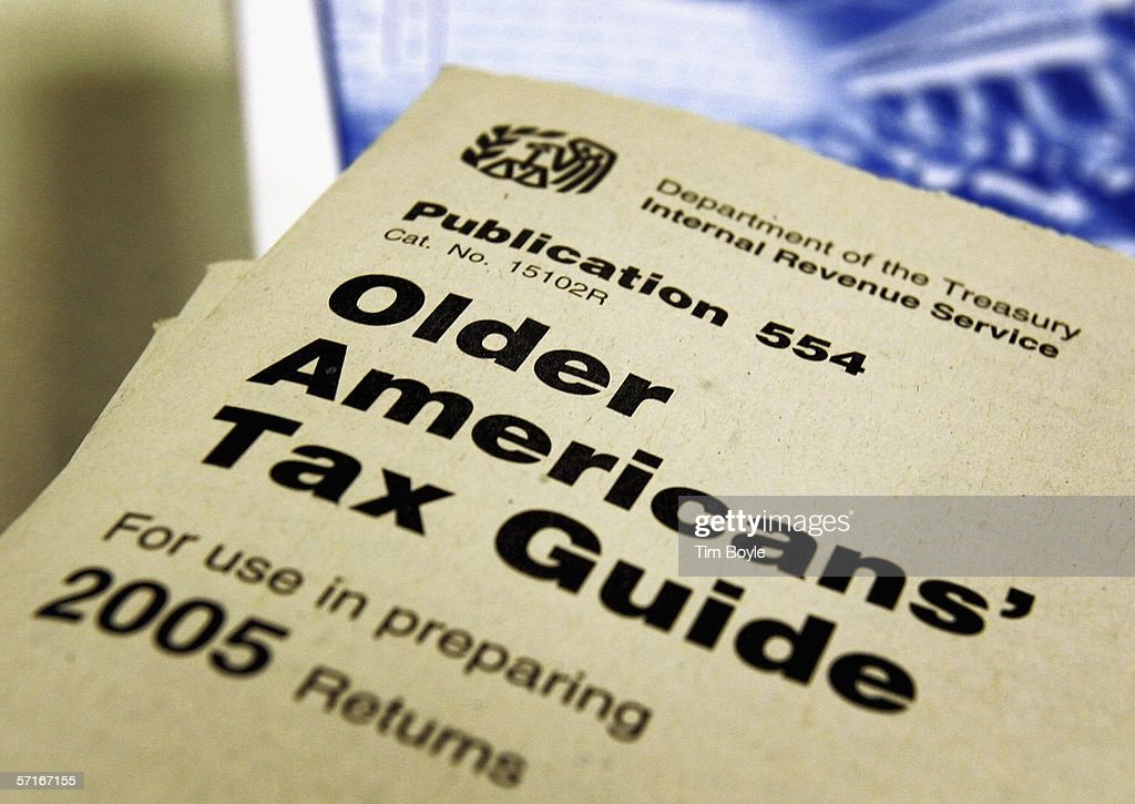 A 2005 tax guide for older Americans is seen at the Des Plaines Public Library March 23, 2006 in Des Plaines, Illinois. As next month's income tax deadline approaches, Americans are preparing for it by using tax software, filing out paper forms or by using a tax preparer.