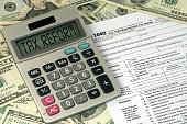 tax reform text sign on calculator with income tax form and American money