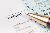 Close-up of Refund on a tax return form with a pen.