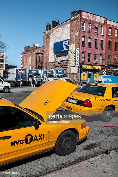 Taxi and yellow cab repairs on street