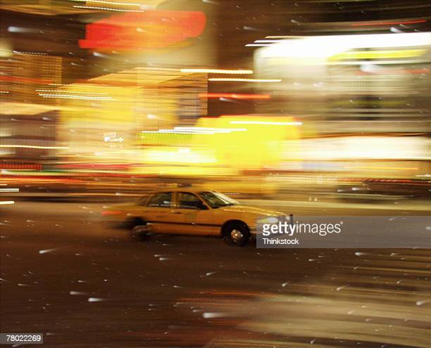 Taxi cab driving through Times Square, New York City