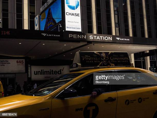 A taxi cab passes in front of Pennsylvania Station in New York US on Friday May 26 2017 PresidentDonald Trumptapped New York developerSteven...