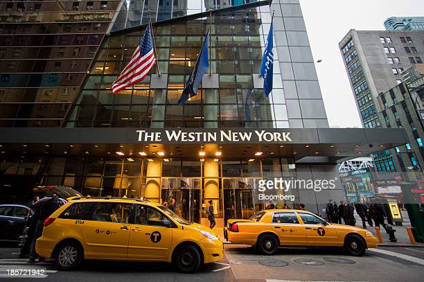Taxi cabs drive past The Westin New York a Starwood Hotels Resorts Worldwide Inc property in New York US on Wednesday Oct 23 2013 Starwood Hotels...