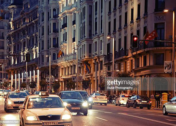 Taxi cabs driving through Calle Gran Via, Madrid