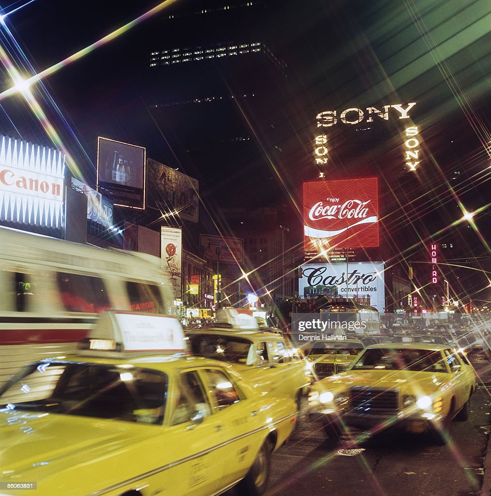 Taxi cabs in Times Square , New York City