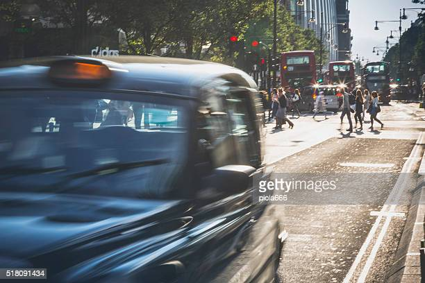 Taxi cabs of London in rush hours