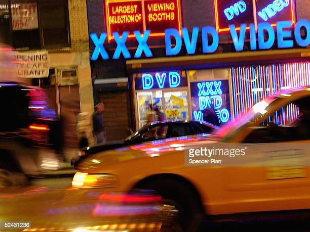 Taxi cabs pass an adult video store in Times Squre March 15 2005 in New York City Sexrelated shops have started to make a comeback in Times Square...
