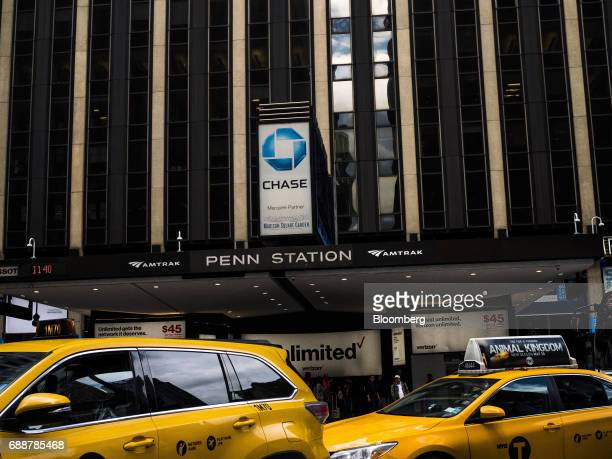 Taxi cabs pass in front of Pennsylvania Station in New York US on Friday May 26 2017 PresidentDonald Trumptapped New York developerSteven Rothas...
