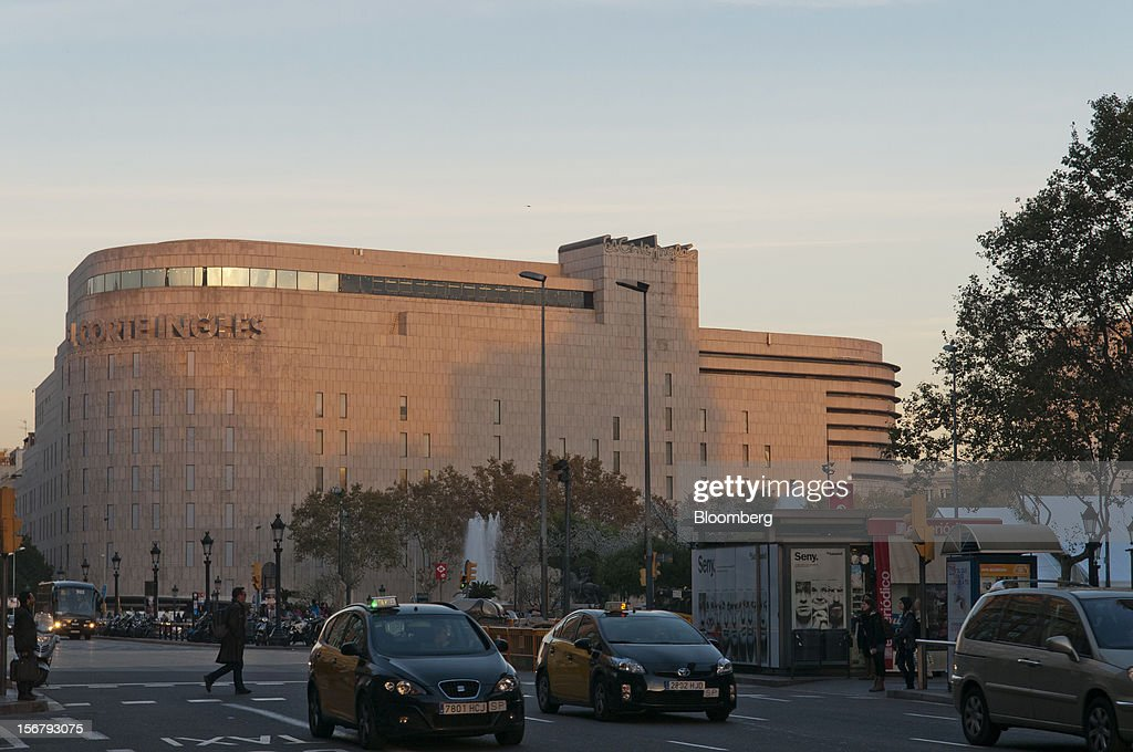 Taxi cabs pass the El Corte Ingles department store at Plaza Catalunya in Barcelona Spain on Tuesday Nov 20 2012 Bank of Spain Governor Luis Maria...