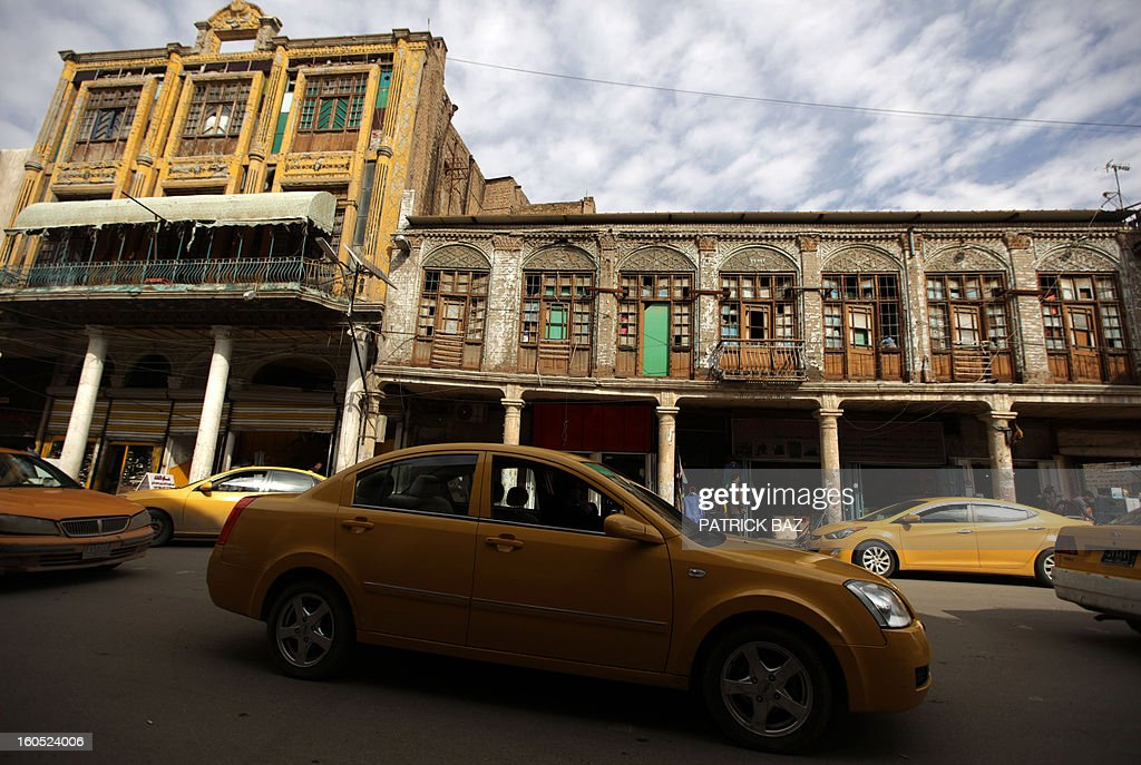 Taxi cabs queue in Baghdad's Rashid Street, the oldest street of the Iraqi capital, on February 2, 2013.