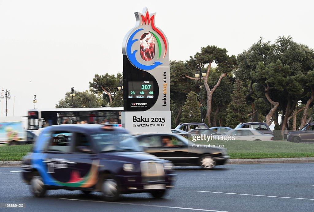 A taxi car drives past a Baku 2015 clock on August 6 2014 in Baku Azerbaijan
