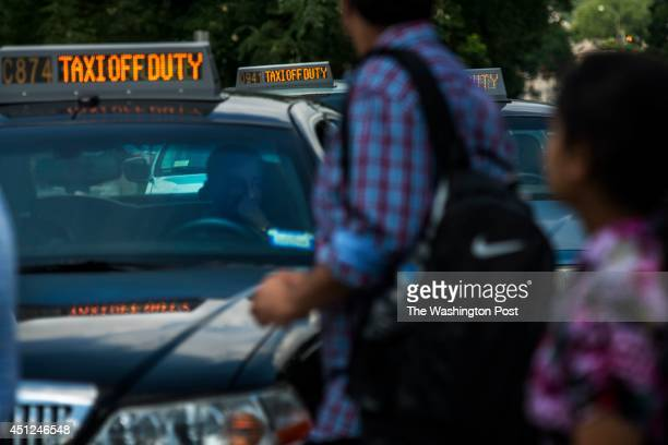 A taxi caravan of hundreds drove slowly and honked car horns as they hold up traffic on Constitution Avenue refusing to take fares from 11 am to 12...