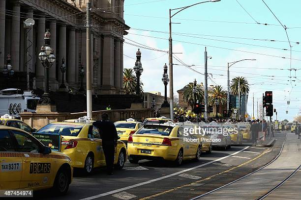 Taxi cars are lined up as protesters gather on September 10 2015 in Melbourne Australia Tram drivers are striking for over a pay dispute between...
