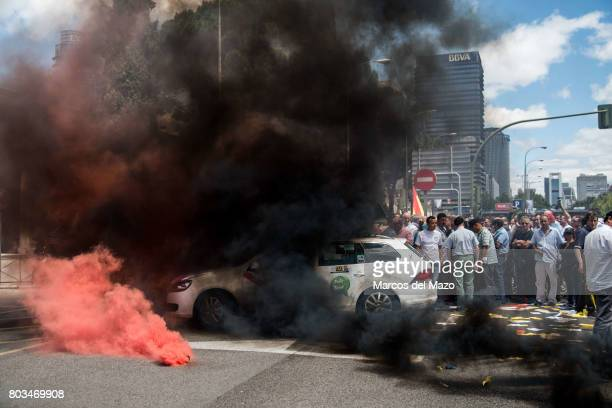 A taxi covered with smoke during a protest against Uber and Cabify demanding government to obey law demanding just one Uber per 30 taxis