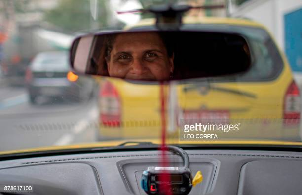 Taxi driver Carla Iorio Aguiar poses for the picture inside her cab in Rio de Janeiro Brazil on November 24 2017 Next November 25 marks the...