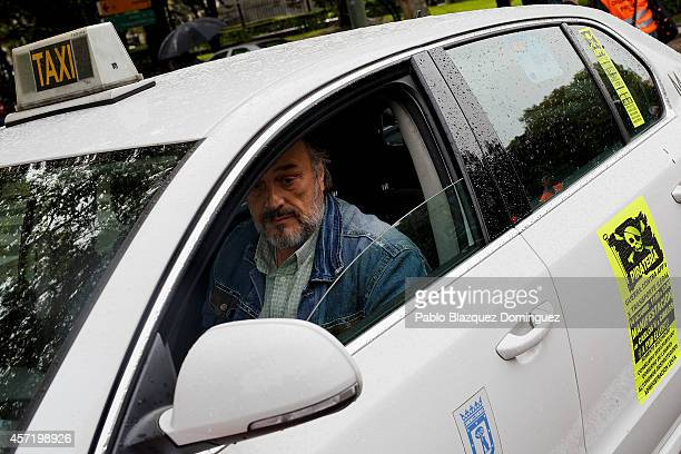 Taxi driver drives his car during a protest against new private cab 'UBER' application on October 14 2014 in Madrid Spain 'Uber' application started...