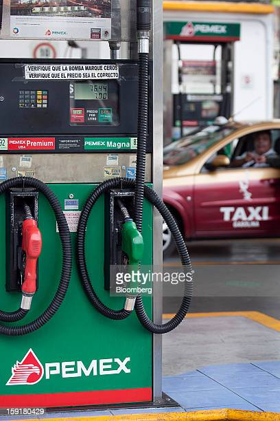 A taxi driver gets his vehicle's tank filled with gasoline at a Pemex station in Mexico City Mexico on Tuesday Jan 8 2013 Mexico's government is...