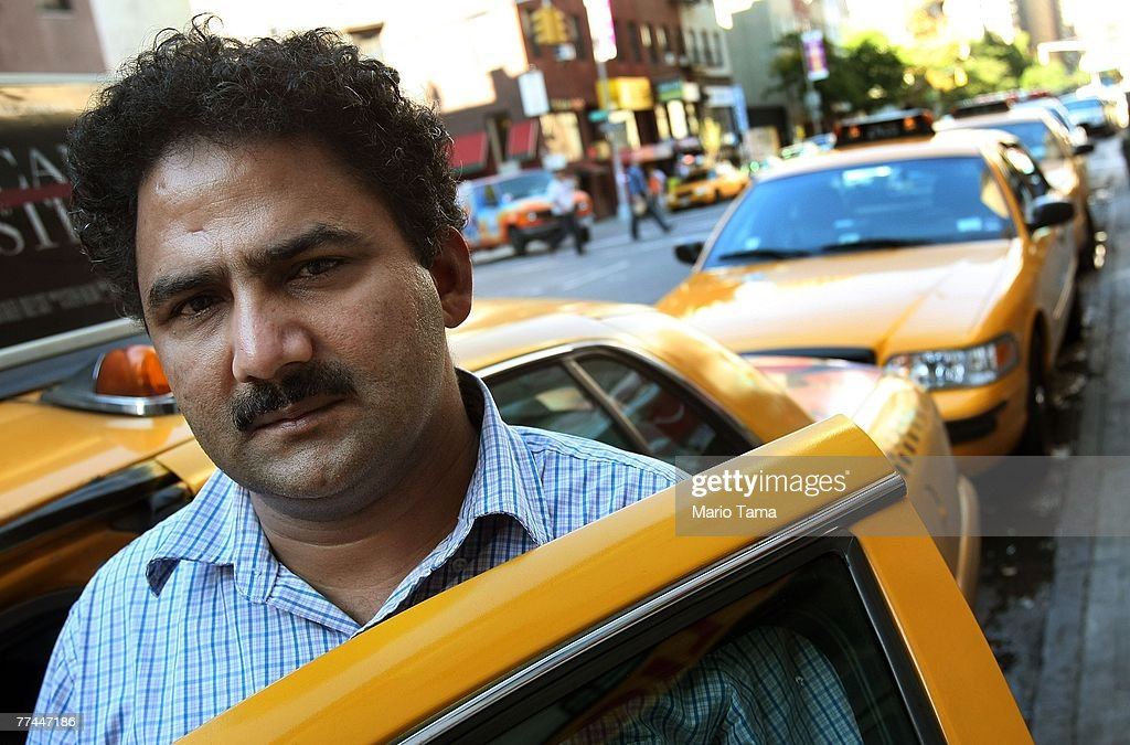 Taxi driver Hussain Hussain stands by his cab October 22, 2007 in New York City. Some city taxi drivers went on 24-hour strike today protesting the installation of GPS tracking systems and credit card machines.