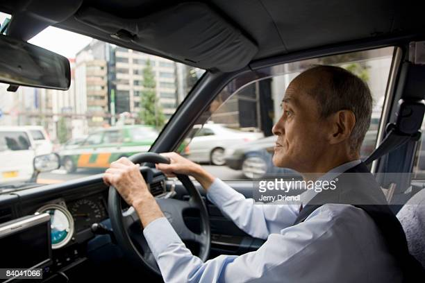 A taxi driver operating his vehicle