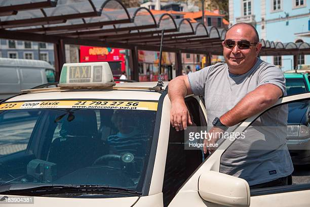 Taxi driver outside Santa Apolonia train station