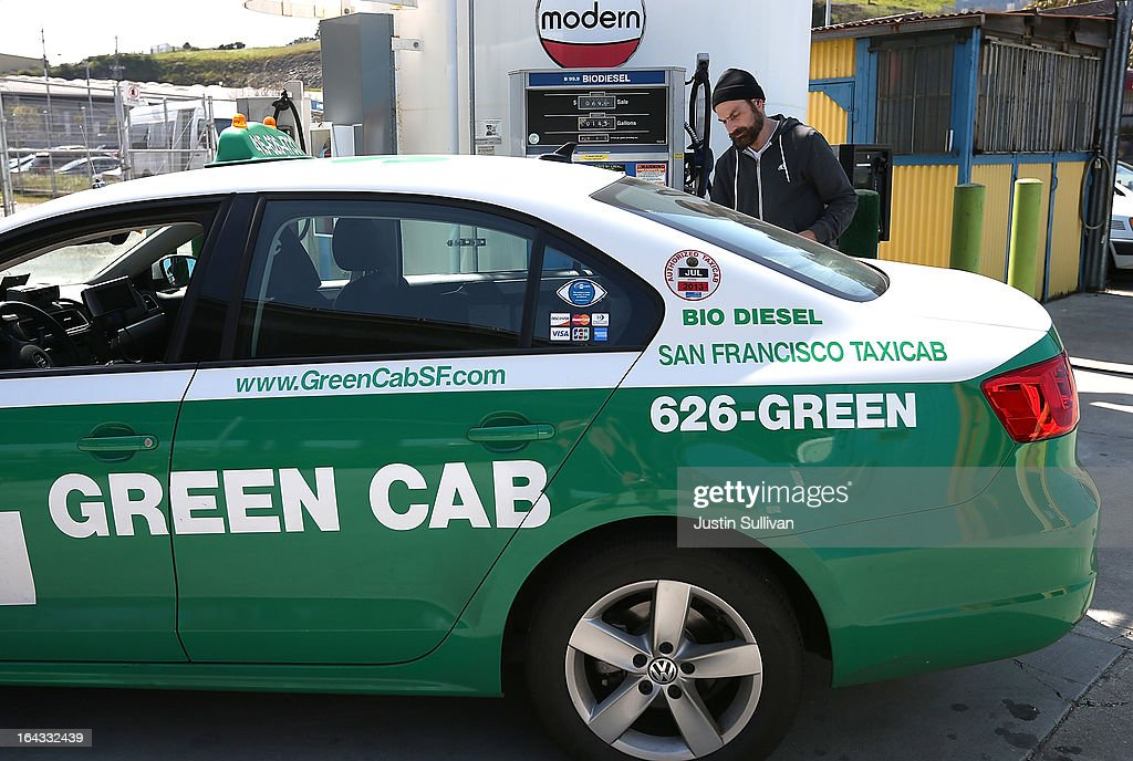 A taxi driver pumps biodiesel into his cab at Dogpatch Biofuels on March 22 2013 in San Francisco California According to a report by San Francisco...
