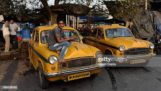A taxi driver relaxes on his cab on December 1 2012 in Kolkata India