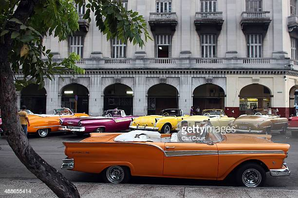 A taxi driver sits in a vintage American car on September 16 2015 in Havana Cuba Pope Francis is due to make a three day visit to Cuba from September...