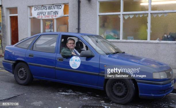 Taxi driver Tom Matthews sitting in his 'high speed' Vauxhall Cavalier outside the taxi office in Newport south Wales