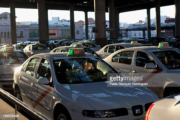 A taxi driver waits for customers at a cab rank in Atocha Train Station on November 13 2012 in Madrid Spain Spain's trade unions have called a...