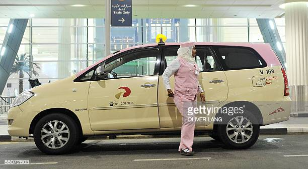 A taxi driver wearing a pink uniform waits for a passenger at Dubai airport on May 30 2009 The German national football team arrived on May 30 in...