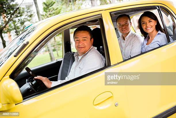 Taxi driver with passengers