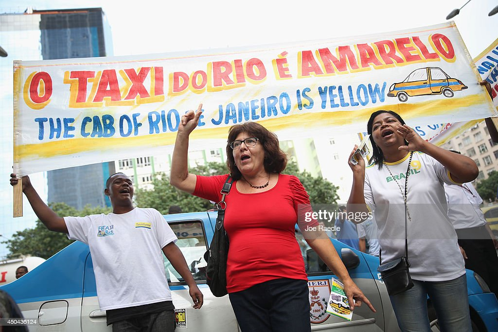 Taxi drivers and their supporters stage a small rally and partial road blockage a day before the start of the World Cup tournament as drivers protest Uber, a U.S. car service which allows people to summon rides with their cell phone on June 11, 2014 in Rio de Janeiro, Brazil. There are reports that indicate protests against the government will continue throughout World Cup play by those unhappy with the billions of dollars that the country spent on preparing for the World Cup when they feel their are so many other places they would have liked the government to spend the money.