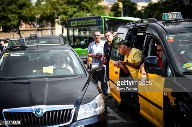 Taxi drivers argue with a taxi driver who was working at Barcelona Sants Train Station during a 24 hours strike against smart phone App 'Uber' on...