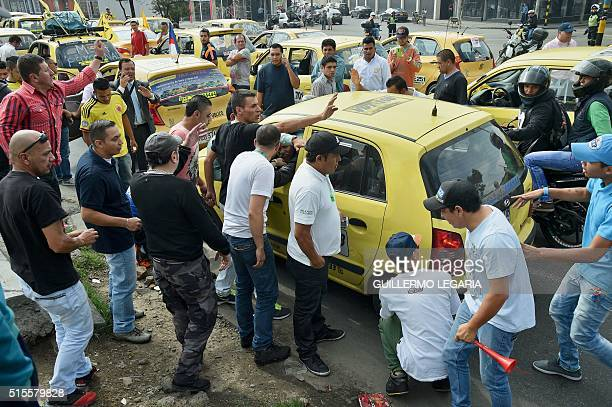 Taxi drivers attack a fellow coworker who does not join their protest against the Uber taxibooking mobile app in Bogota on March 14 2016 The protest...