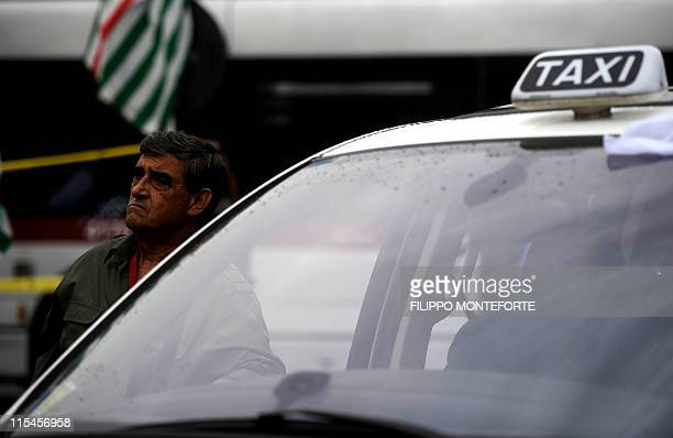 Taxi drivers attend a protest on June 7 2011 as about 90% of Roman taxi drivers went on strike against Rome Mayor Gianni Alemanno's transport policy...