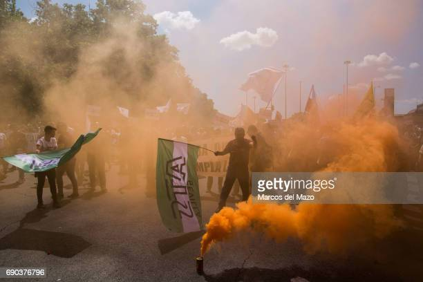 Taxi drivers covered by smoke during a demonstration against private services such as Uber and Cabify demanding Government to apply transport...
