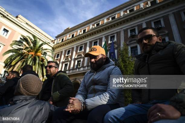 Taxi drivers demonstrate in front of the Infrastructure and Transportation Ministry in Rome to protest against the EU's Bolkestein directive on...
