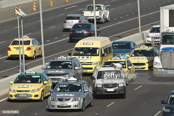 Taxi drivers drive slowly and block traffic on the Tullamarine Freeway on February 27 2017 in Melbourne Australia Hundreds of taxi drivers met near...