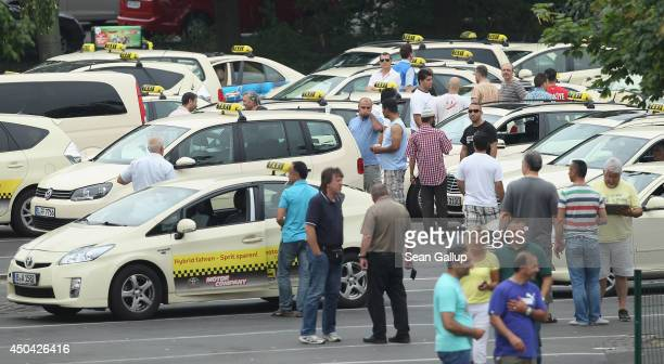 Taxi drivers gather at Tegel Airport before many of them joined a protest through the city on June 11 2014 in Berlin Germany Approximately 1000 taxis...