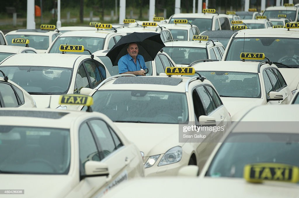 Taxi drivers gather next to the Olympia Stadium to protest ride-sharing apps on June 11, 2014 in Berlin, Germany. Hundreds of taxi drivers arrived to demonstrate in a protest that coincided with similar protests in cities across Europe against new apps like Wundercar and Uber that the taxi drivers claim are undermining their livelihood and creating unfair competition.