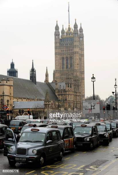 Taxi drivers in Parliament Square London as they protest over a rank for private vehicles