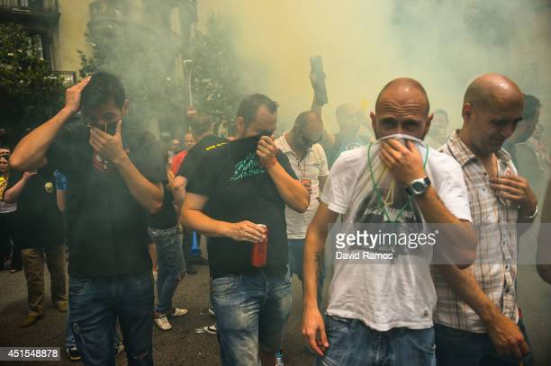 Taxi drivers protest against a new smart phones app 'Uber' during a 24 hours strike on July 1 2014 in Barcelona Spain Taxi drivers in main cities...