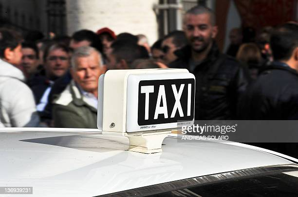 Taxi drivers protest against measures to liberalise services on transport for the taxis of the Italian government in front of Palazzo Chigi Italy's...