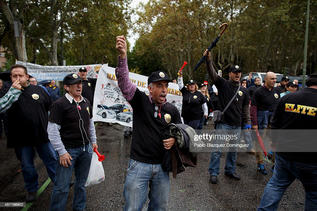 Taxi drivers protest against new private cab 'UBER' application on October 14, 2014 in Madrid, Spain. 'Uber' application started to operate in Madrid last September despite Taxi drivers claim it is an illegal activity and its drivers currently operate without a license. 'Uber' is an American based company which is quickly expanding to some of the main cities from around the world.