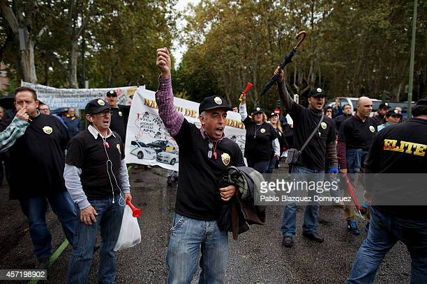 Taxi drivers protest against new private cab 'UBER' application on October 14 2014 in Madrid Spain 'Uber' application started to operate in Madrid...