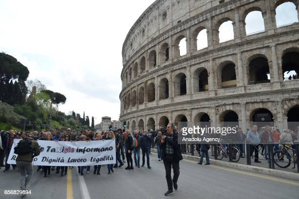 Taxi drivers protest in Rome in response to an amendment that drivers say will favor smartphone appbased car transport company Uber and unfair...