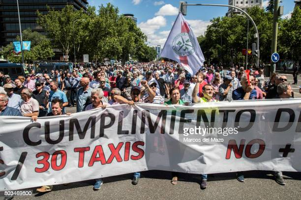 Taxi drivers protesting against Uber and Cabify demanding government to obey law demanding just one Uber per 30 taxis