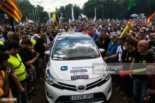 Taxi drivers protesting during a demonstration against private services such as Uber and Cabify demanding Government to apply transport regulation law