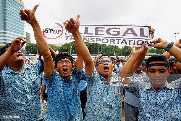 Taxi drivers shout slogans in front of the parliament building during a protest rally to demand the government to prohibit ridehailing apps